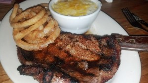 Cajun Ribeye with Onion Rings and Cheese Grits